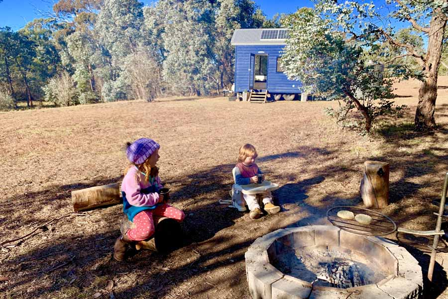 daisy and jasper sharing a campfire yarn at walden in the southern tablelands