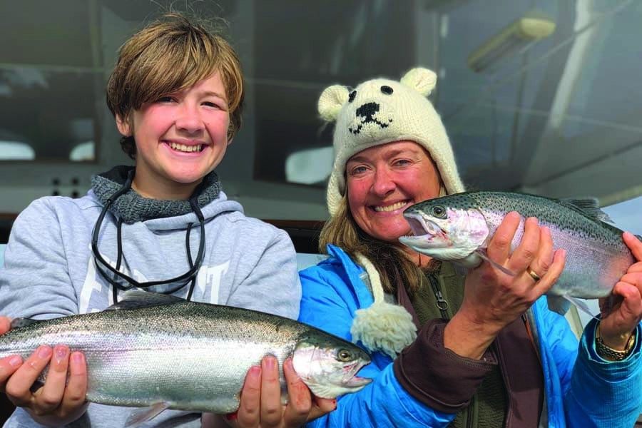 elisabeth and theo showing off their catch at taupo