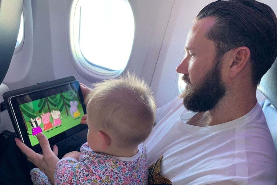 liam keeping kensington entertained on the plane