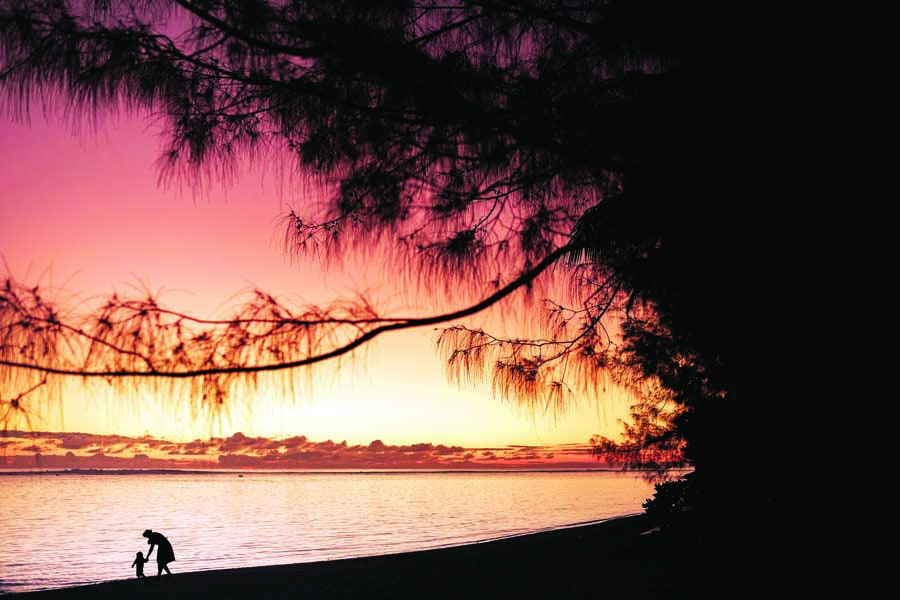 sunset on the beach in front of the rarotongan. image chris van hove