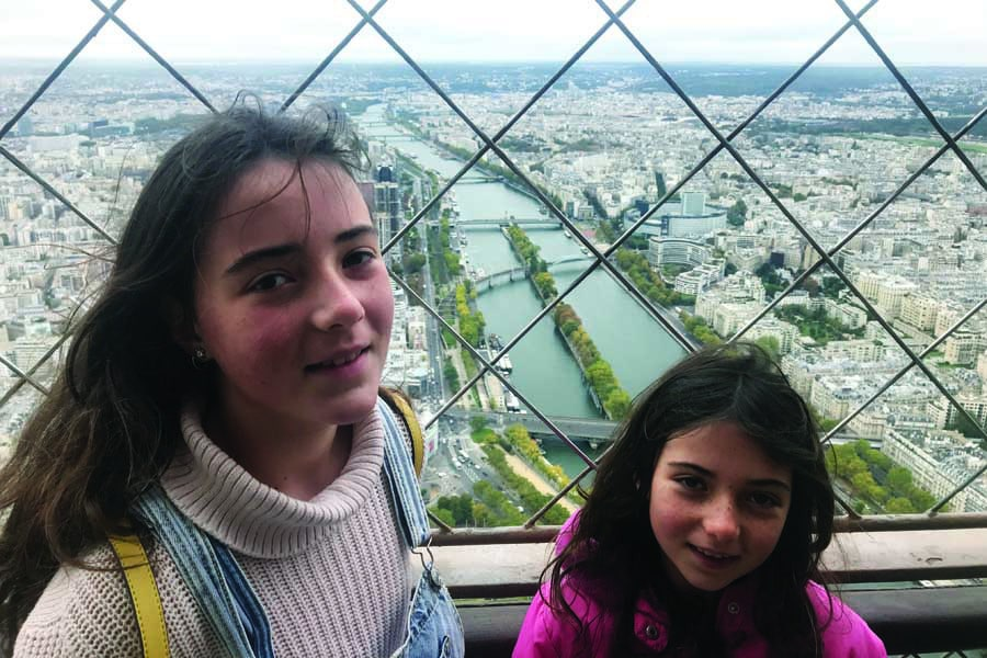 the girls at the top of the eiffel tower