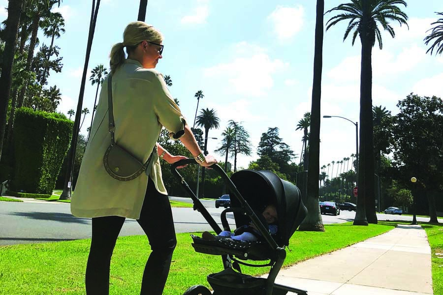 rebecca pushing ruby in the pram in beverly hills when she was a baby