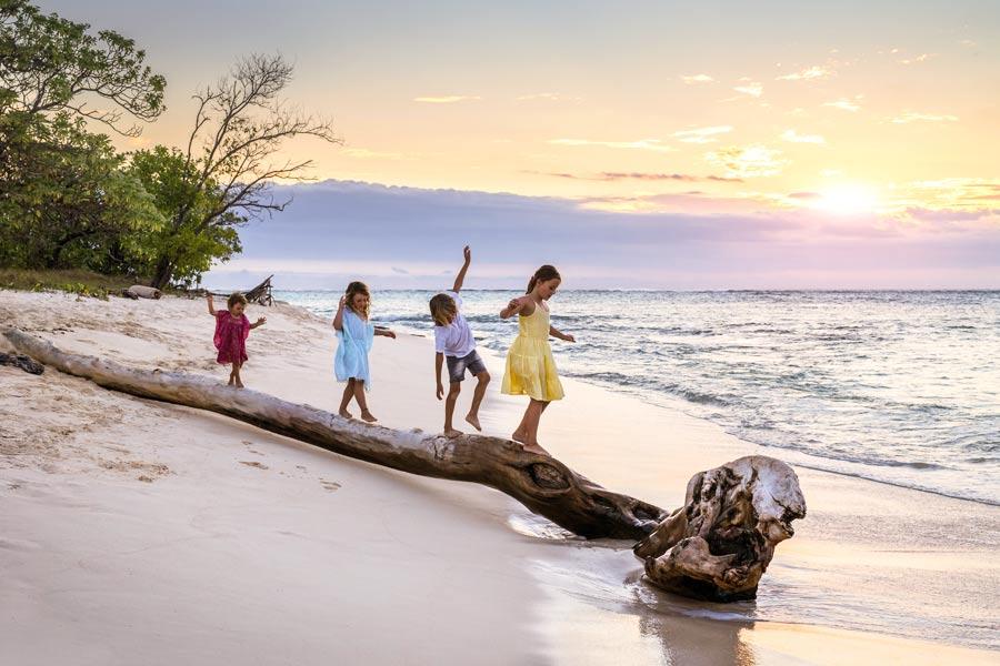 children walking on beach fiji tourism