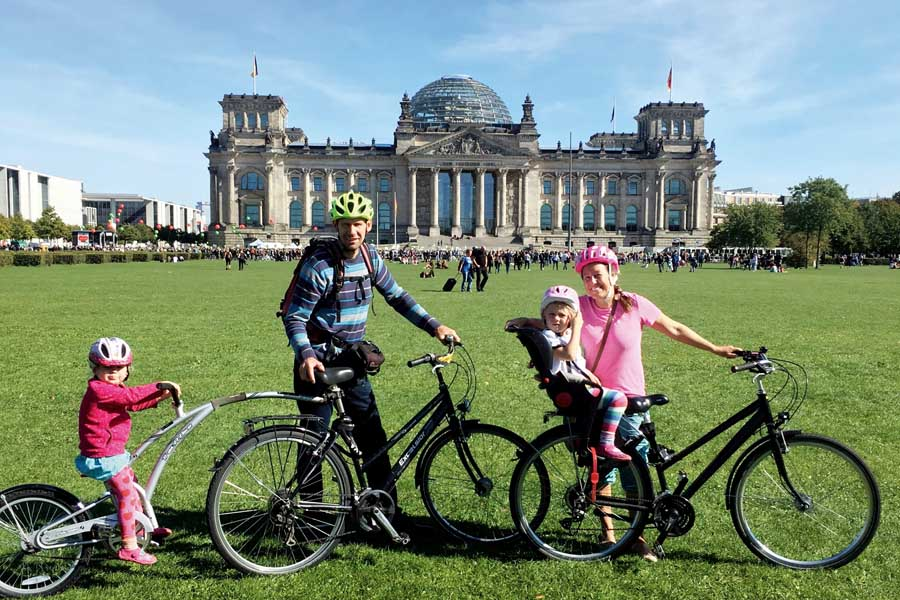 flip byrnes and her family in front of the reichstag in berlin
