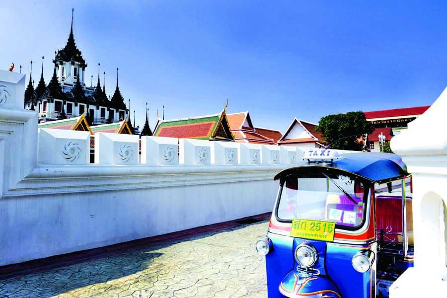 a tuk tuk at wat ratchanatdaram in bangkok
