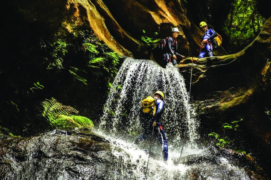canyoning at empress falls in the blue mountains. image david hill destination nsw