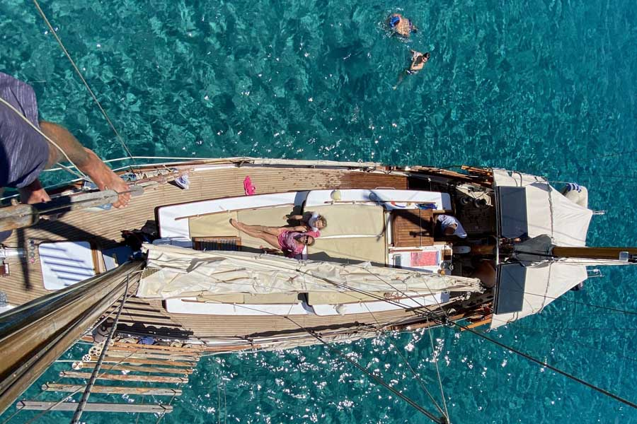 climbing the mast of a clipper while sailing paros