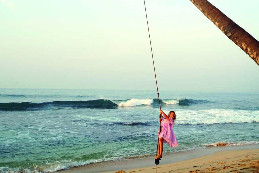 emmie swinging at dalawella beach