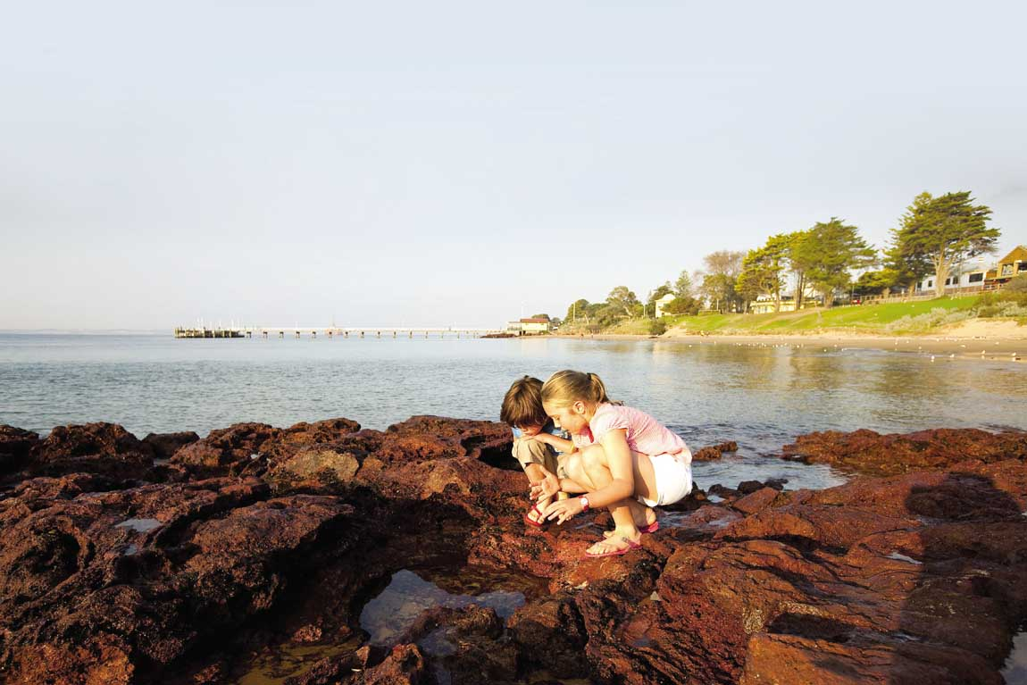 feature kids exploring at cowes on phillip island. image visit victoria