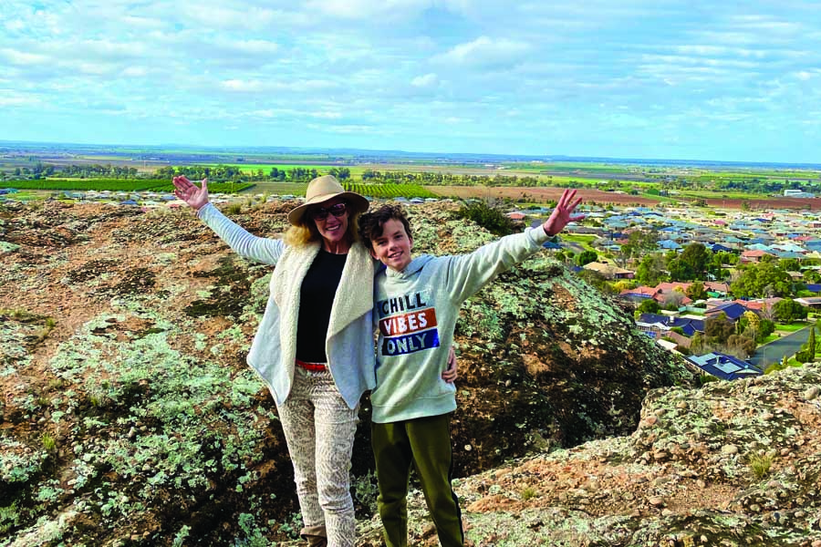 katrina and remy enjoying panoramic riverina valley views from the clifftop plateau of the hermits cave griffith