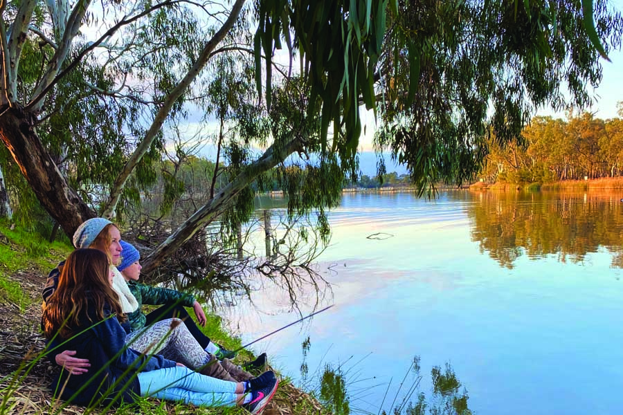 katrina and the kids relaxing by the river
