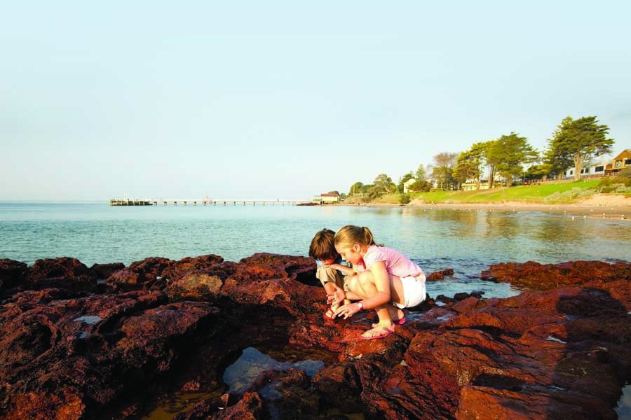 kids exploring at cowes on phillip island. image visit victoria