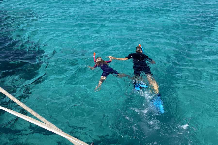 lotte snorkelling with dad from the clipper in paros. image flip byrnes