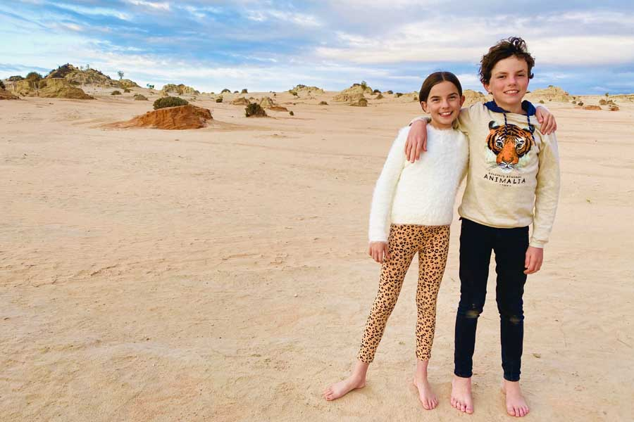maya and remy waiting for the full moon to rise over mungo national park