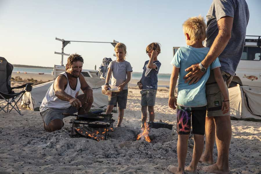 a family around a campfire during a tour with wula gura nyinda eco adventures in the shark bay world heritage area. image tourism western australia