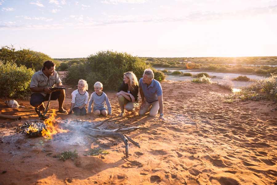 a family around a campfire on an indigenous tour at monkey mia. image tourism western australia