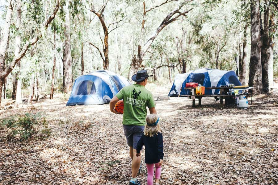 a family camping at lane poole reserve in dwellingup. image tourism western australia