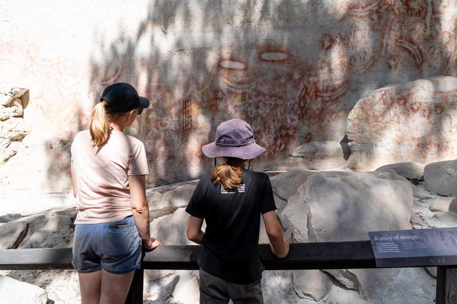 children admiring indigenous rock art at carnarvon gorge in queensland. image tourism and events queensland