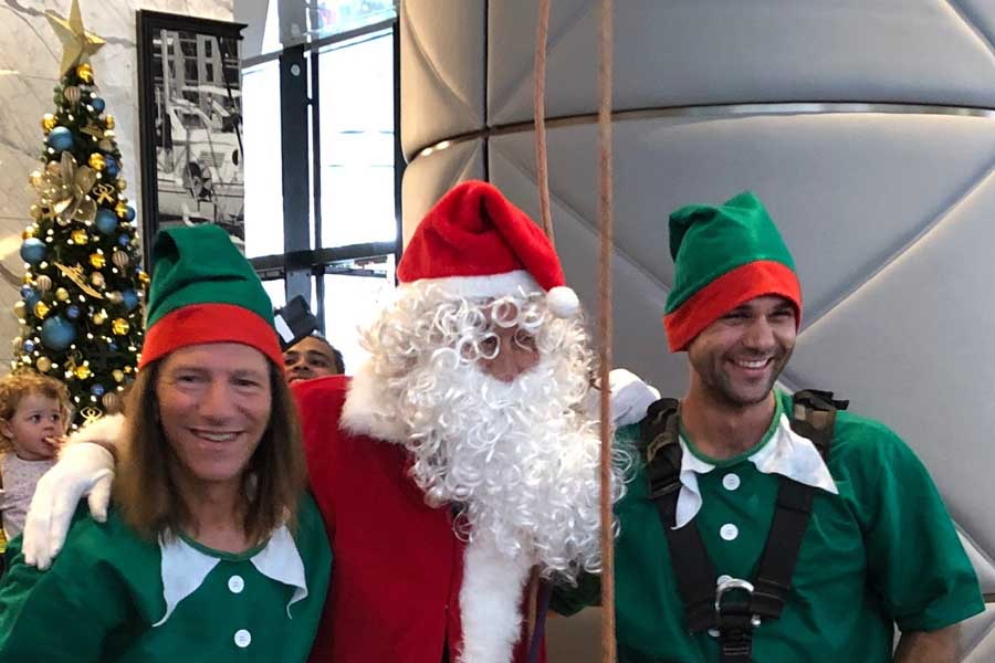 dr jerry schwartz left dressed as an elf at the sofitel sydney darling harbour at christmas