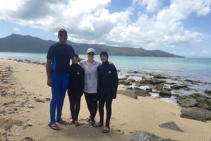 dr monty badami with his daughter aurora wife lara and son baxter on hayman island in queensland