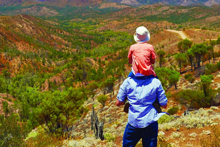 a dad and his daughter at bunyeroo valley lookout in the flinders ranges. image south australian tourism commission