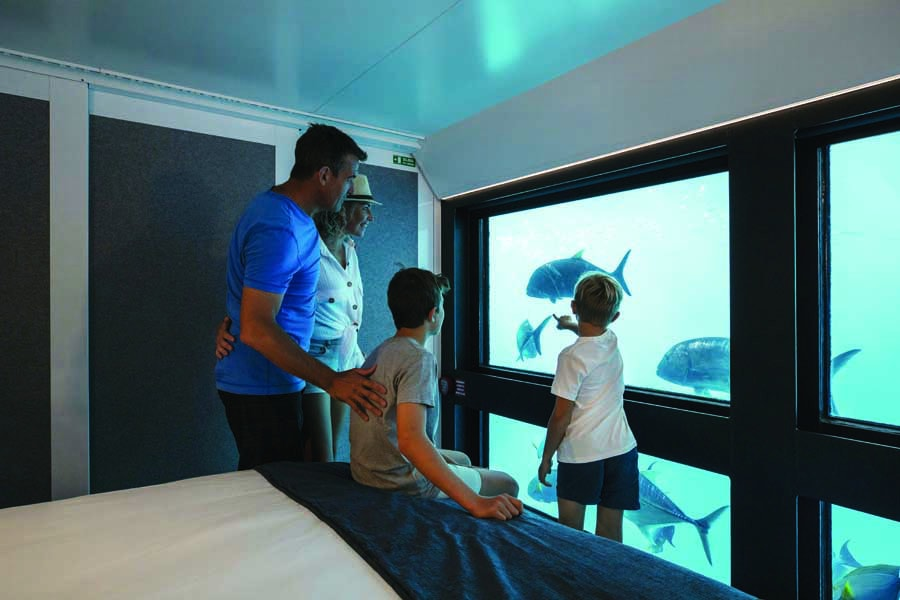 a family at reefsuites on the great barrier reef. image tourism and events queensland