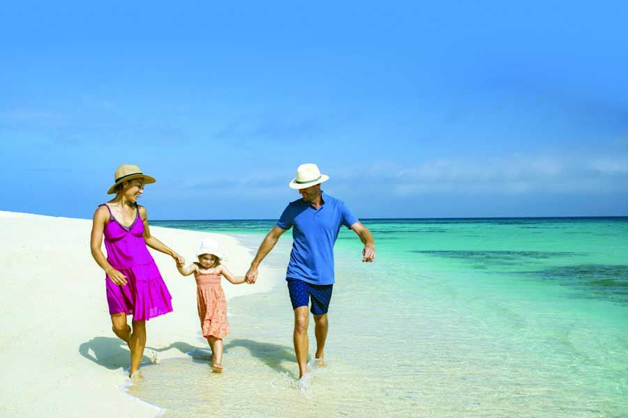 a family on a tour of the great barrier reef with sailaway. image tourism and events queensland