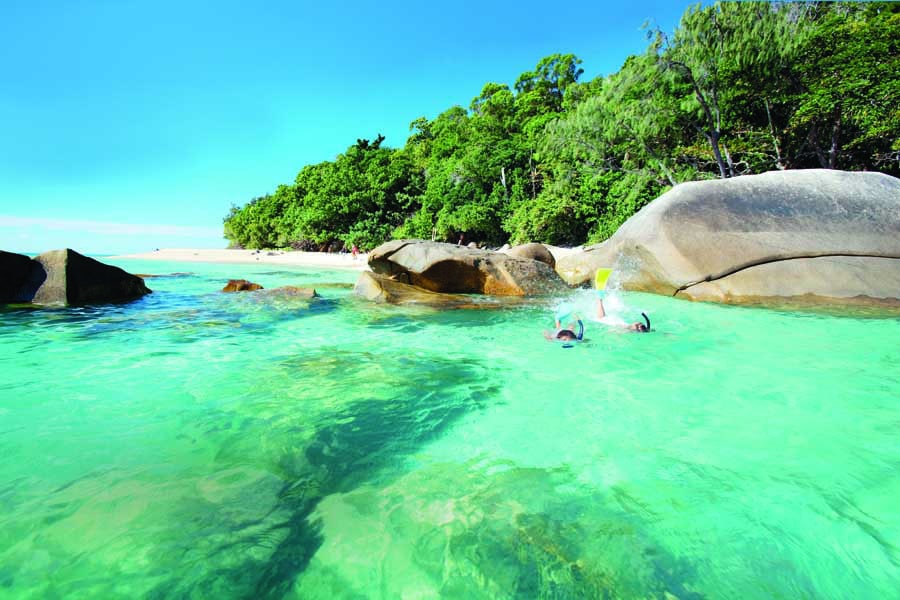 children snorkelling on fitzroy island off the coast of cairns. image tourism and events queensland