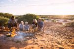 feature a family around a campfire on an indigenous tour at monkey mia. image tourism western australia