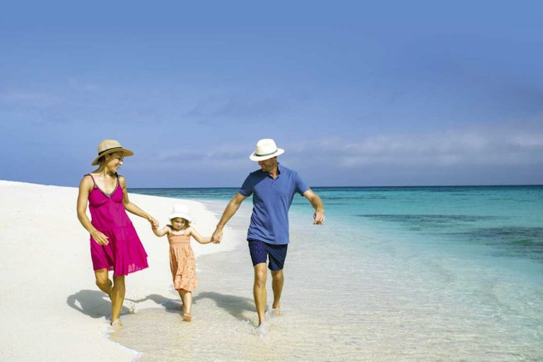 feature a family on a tour of the great barrier reef with sailaway. image tourism and events queensland