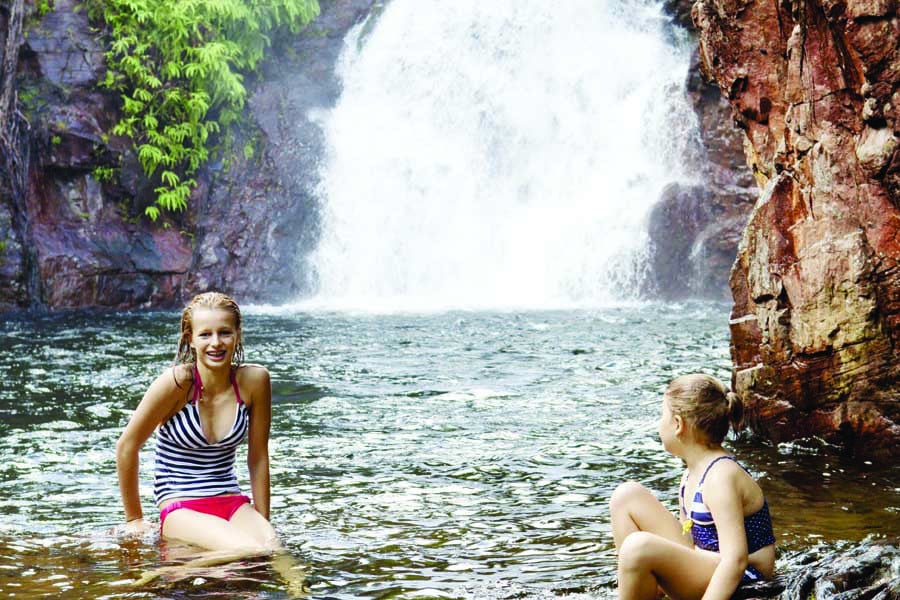 girls at florence falls in litchfield national park. image tourism nt lynton crabb