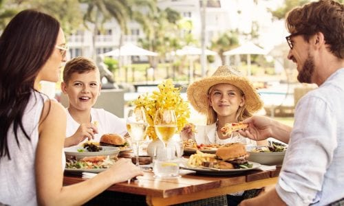 A family enjoying lunch by the pool at Inkstone FEATURE