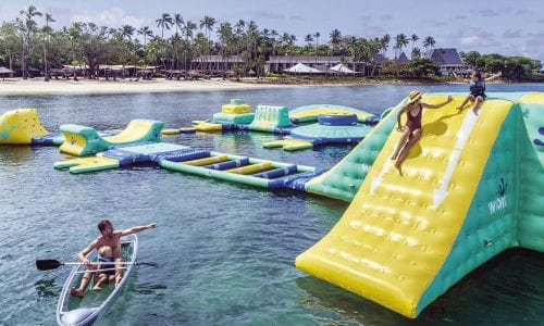 A family enjoying the waterpark at Shangri La Fijian Resort and Spa FEATURE