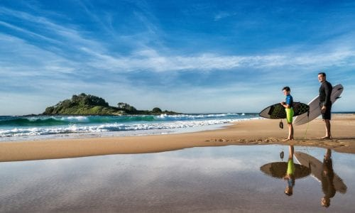 FEATURE A father and son going for a surf at Manyana Beach on the NSW South Coast Image Destination NSW r
