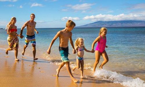 Family on beach 1150x860