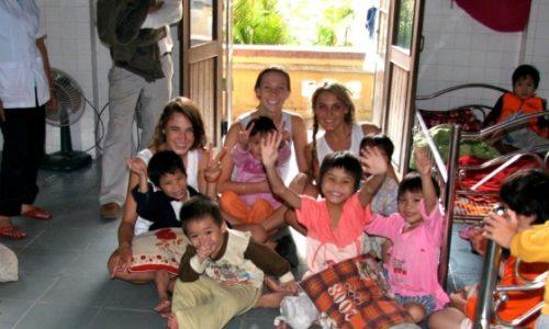 Tori Sam with kids hero